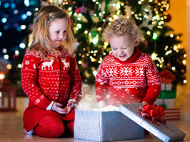 two young kids open xmas presents