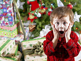 boy screaming with xmas tree in background