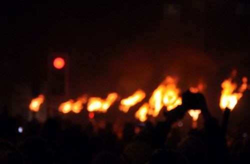 A blurred image of people celebrating Hogmanay at New Years
