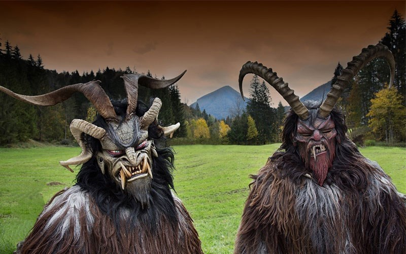 2 people dressed as demons celebrating Krampusnach in Eastern Europe